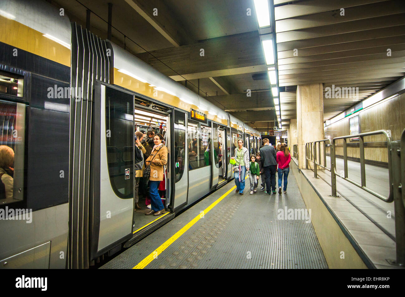 Passengers entering and exiting he smooth and efficient underground trains in Brussels, Belgium. - Stock Image
