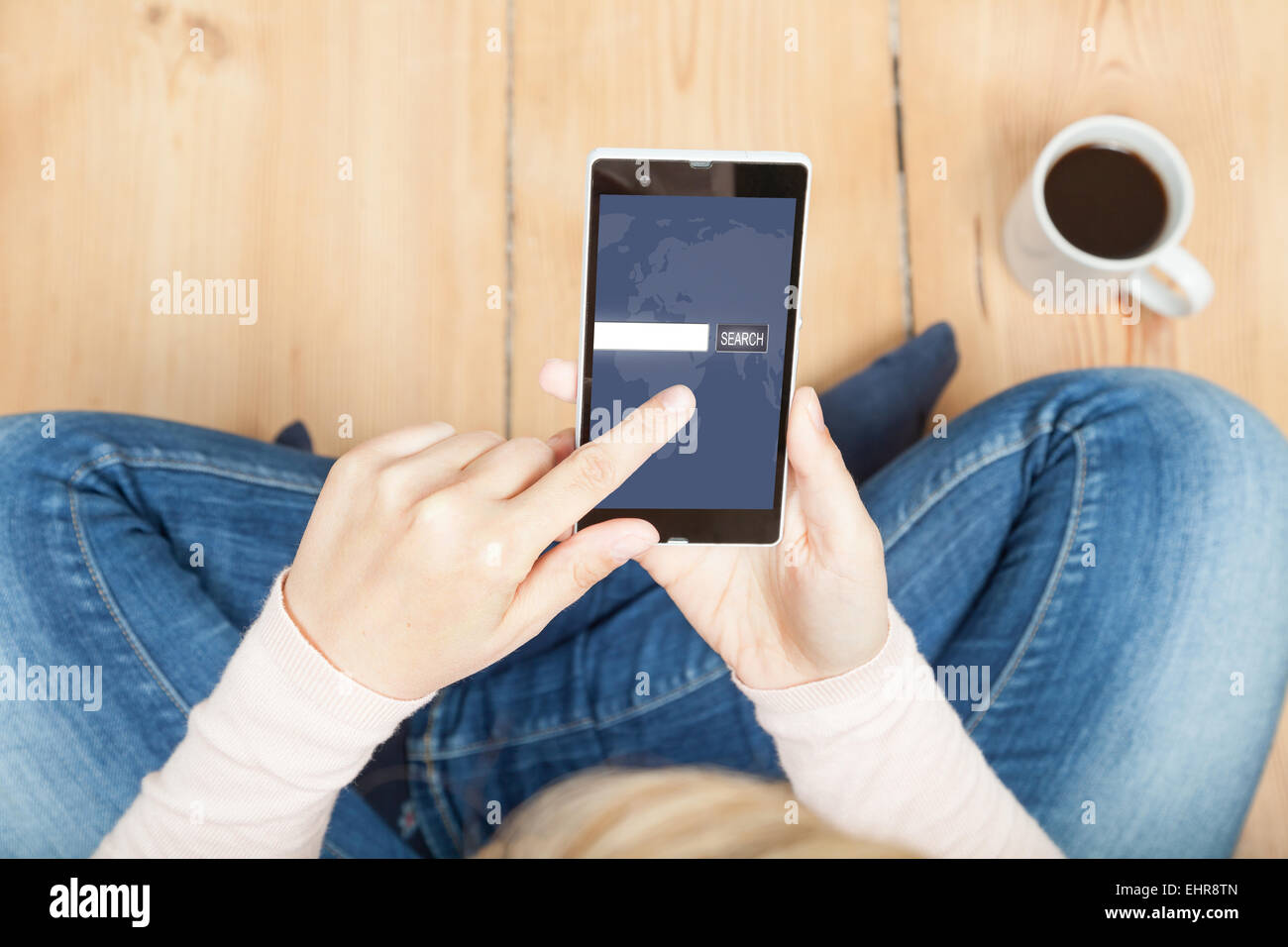 woman uses search engine on smartphone - Stock Image