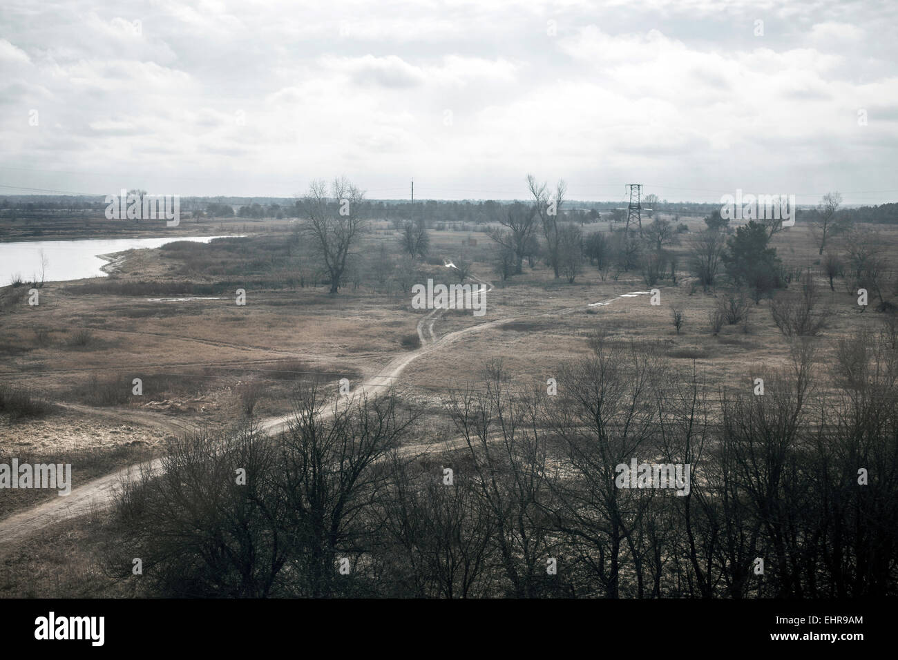 View of a contaminated area from a train that takes the workers of Slavutych to Chernobyl through a stretch of Belarussian - Stock Image