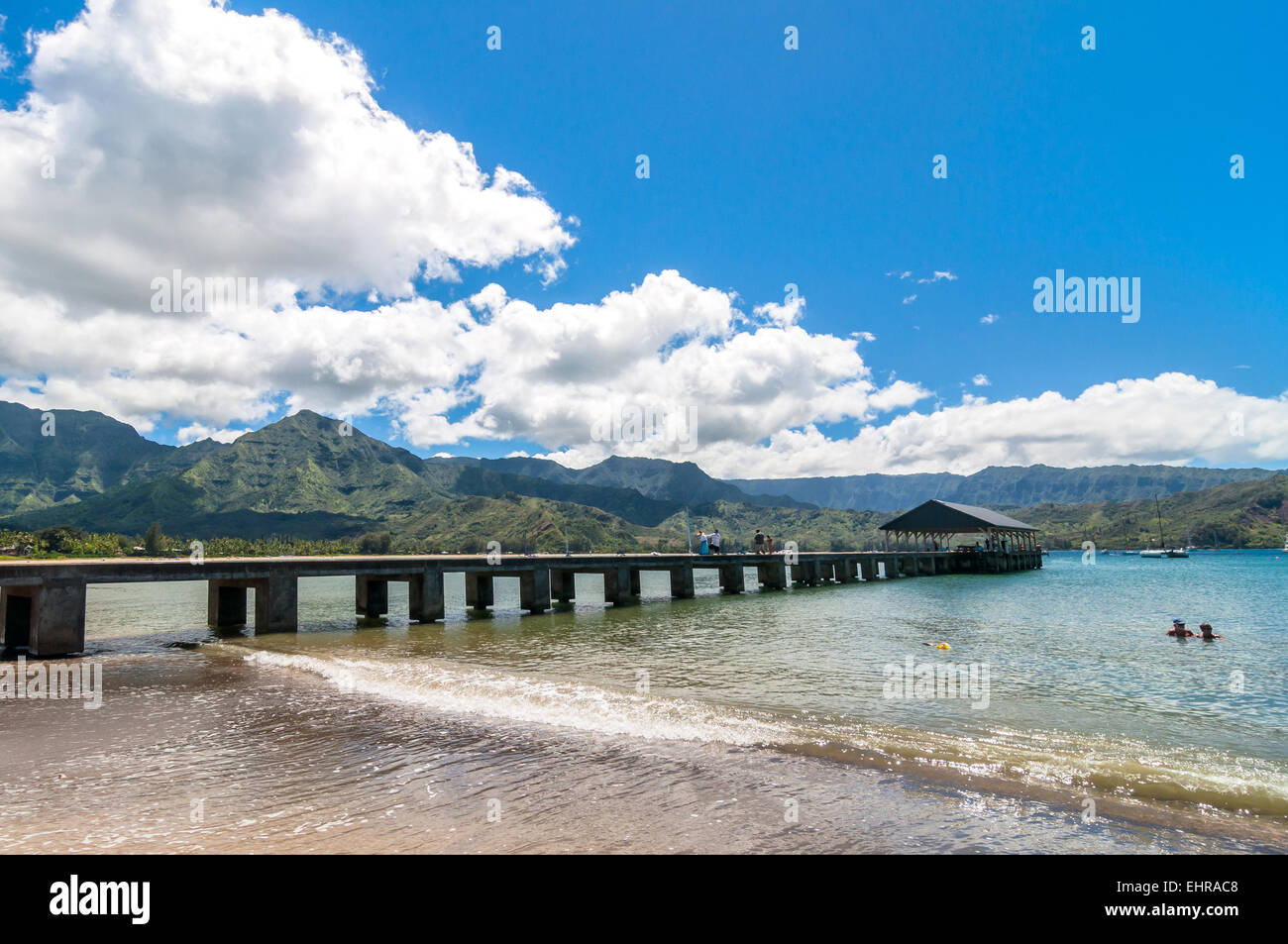 Kauai, HI, USA - August 31, 2013: tourists on Pier and bathing in Hanalei Bay, Kauai Island (Hawaii) - Stock Image