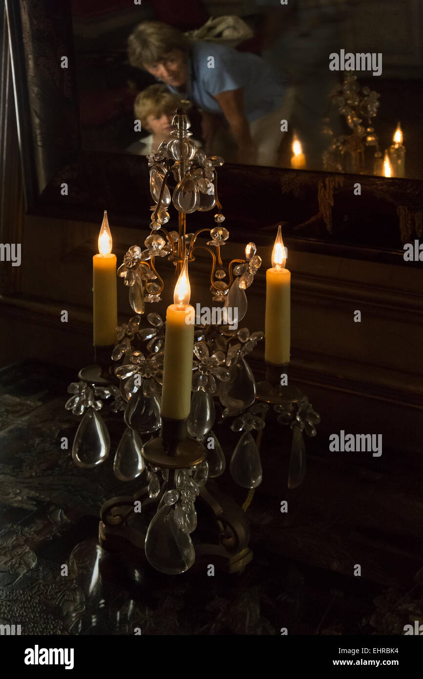 Table Chandeliers and mirror with people in Ham house,London. - Stock Image