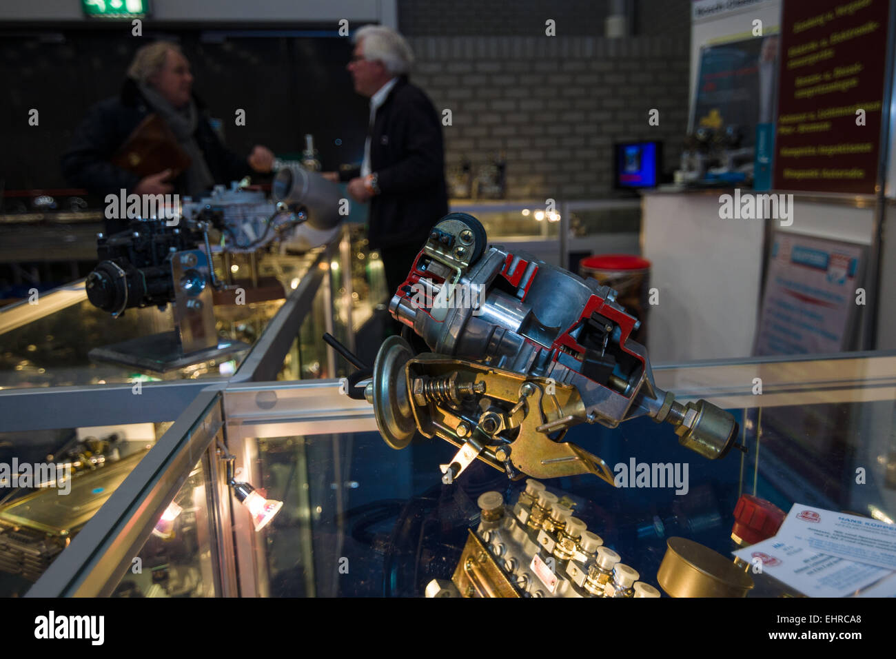 Stand of the firm for the sale of spare parts for oldtimers. In the foreground is the distributor of ignition. - Stock Image
