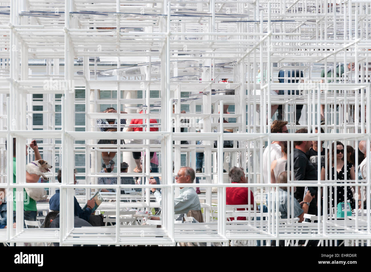 Visitors to the 2013 Serpentine Gallery Summer Pavilion designed by the Japanese architect Sou Fujimoto. - Stock Image