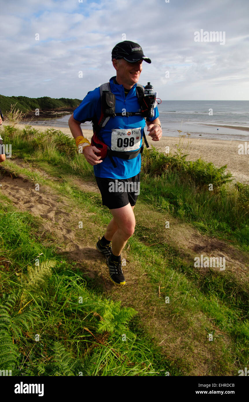 Runners, Ring O Fire Coastal Marathon, Anglesey - Stock Image