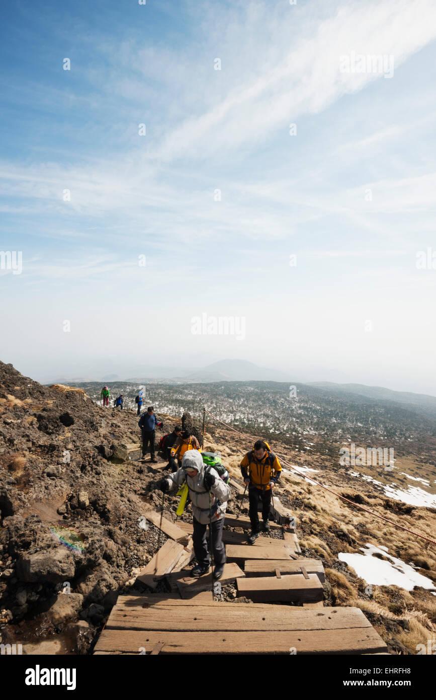 Asia, Republic of Korea, South Korea, Jeju island, hikers on volcanic Mt Halla san, highest mountain in South Korea - Stock Image
