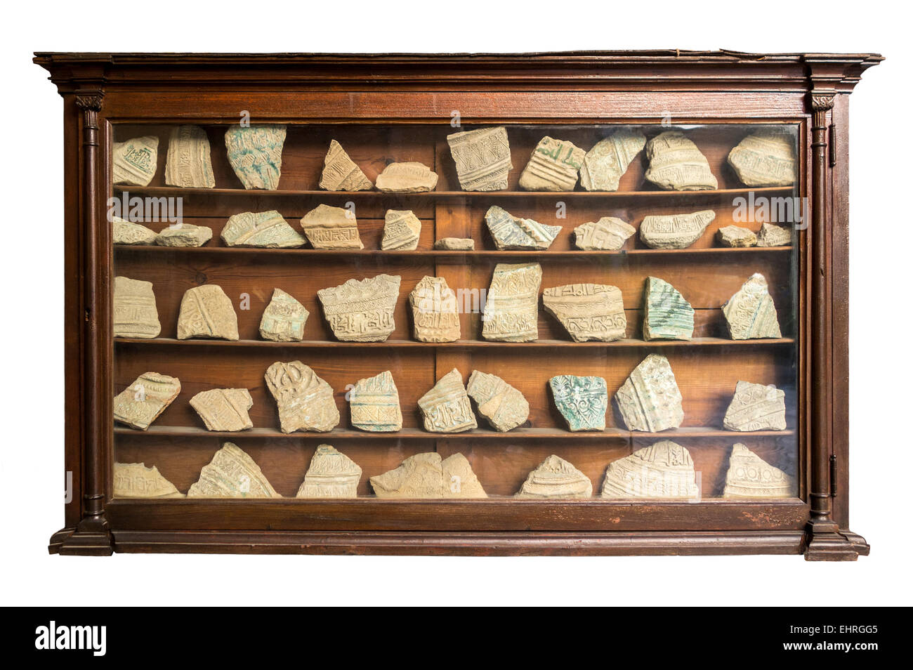 Boring museum display bhz. Old museum showcase cabinet from the 1920's with collection of archeological finds; - Stock Image