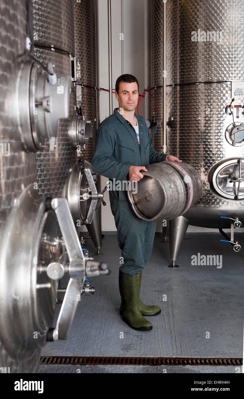 Staff Member holding Beer Barrel at the Hogs Back Brewery in Tongham Surrey - Stock Image