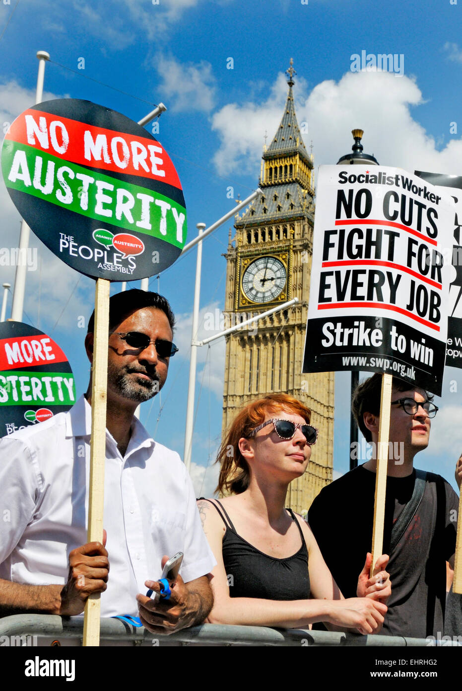 People holding No More Austerity placards at the People's Assembly march against Austerity, London, 21st June - Stock Image