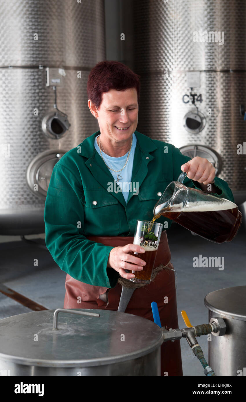 Mo Zeiher Brewer in the fermenting room at the Hogs Back Brewery in Tongham Surrey - Stock Image