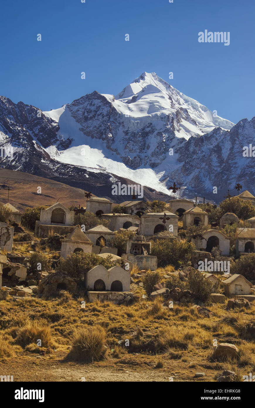 Necropolis with Huayna Potosi mountain in the background, peak in Bolivian Andes - Stock Image