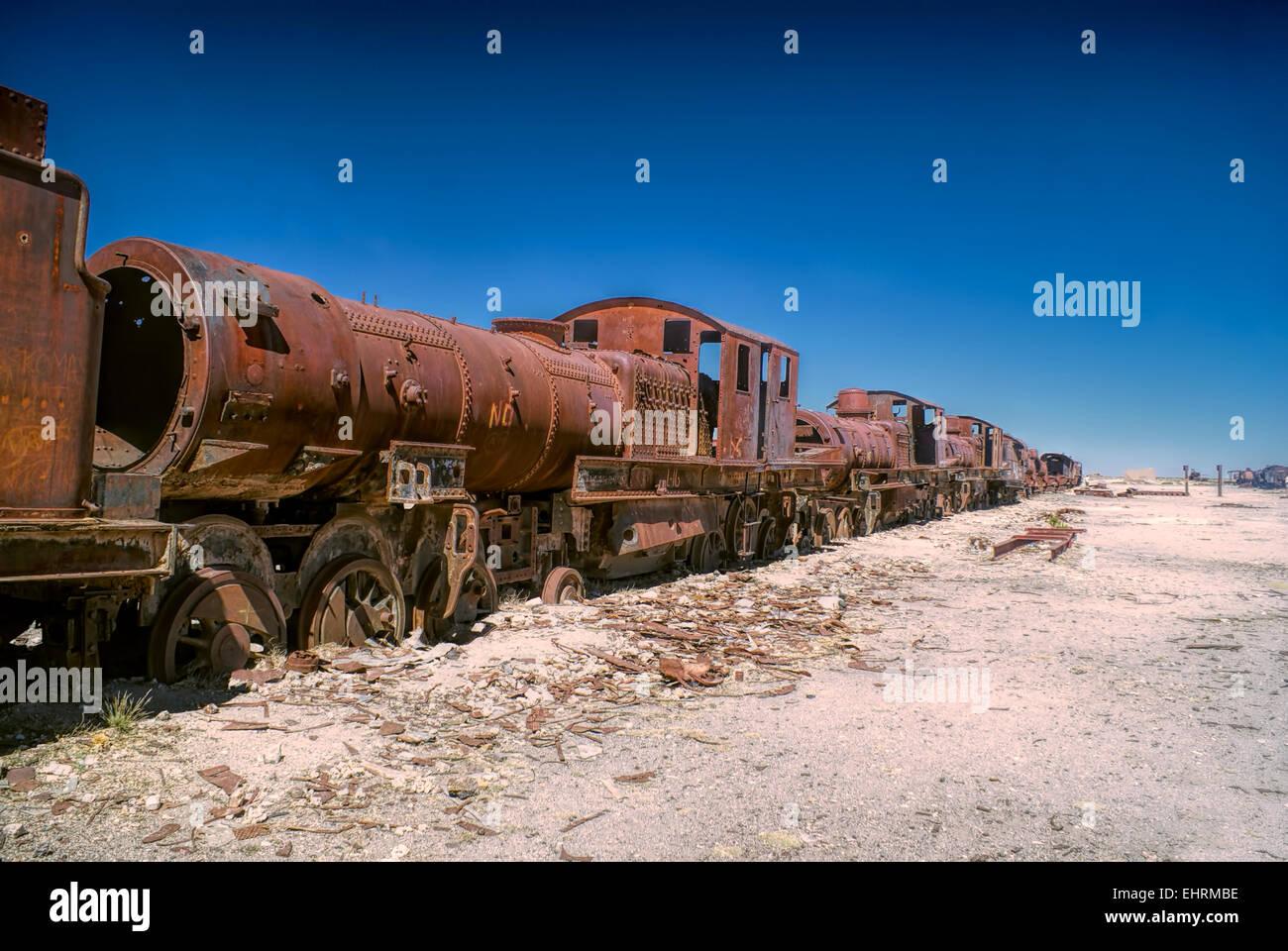 Old locomotive graveyard in desert near Salar de Uyuni in Bolivia - Stock Image