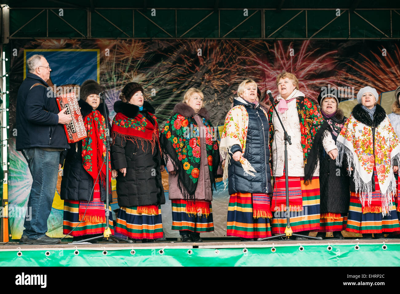 Unknown women group in national clothes at Celebration of Maslenitsa - traditional Russian holiday dedicated to - Stock Image