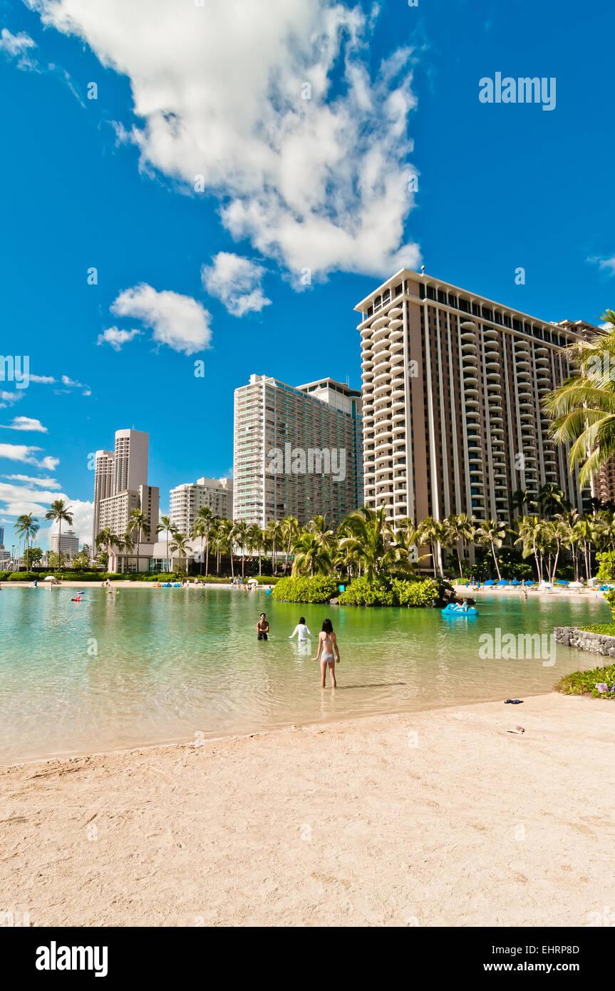 Honolulu, HI, USA - September 7, 2013: tourists sunbathing on Waikiki beach in Honolulu, Hawaii. Waikiki white sand - Stock Image