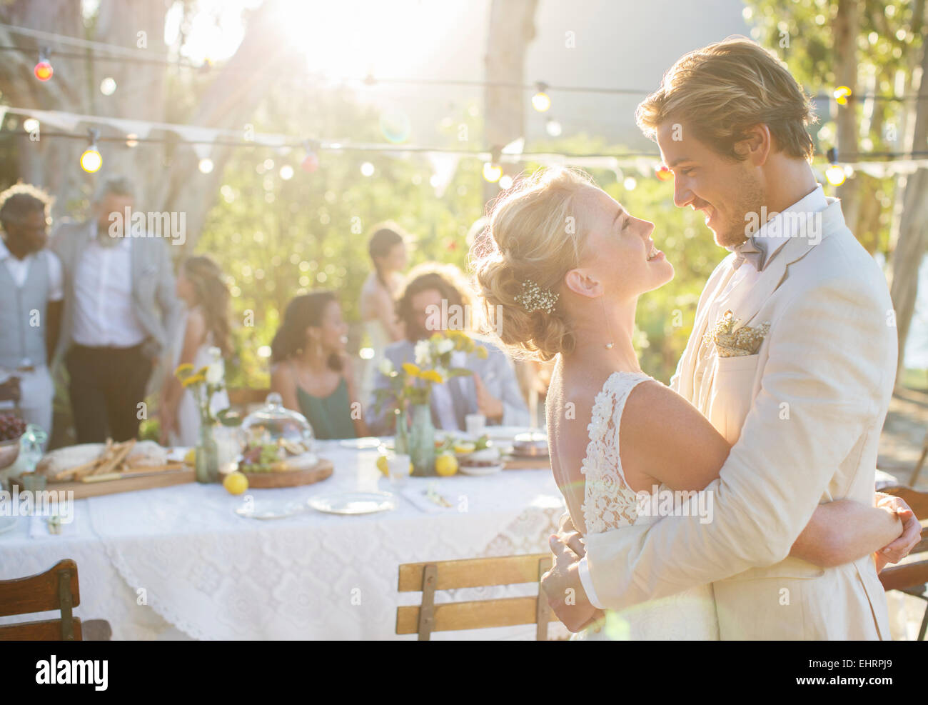 Young couple dancing during wedding reception in domestic garden Stock Photo
