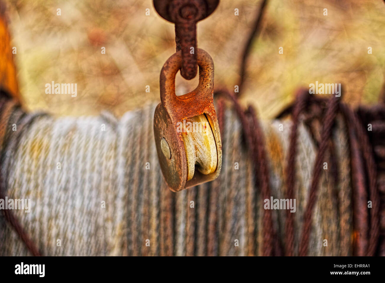 Tackle to pull small boats on shore. Photographed up close, with the wire in the background. - Stock Image