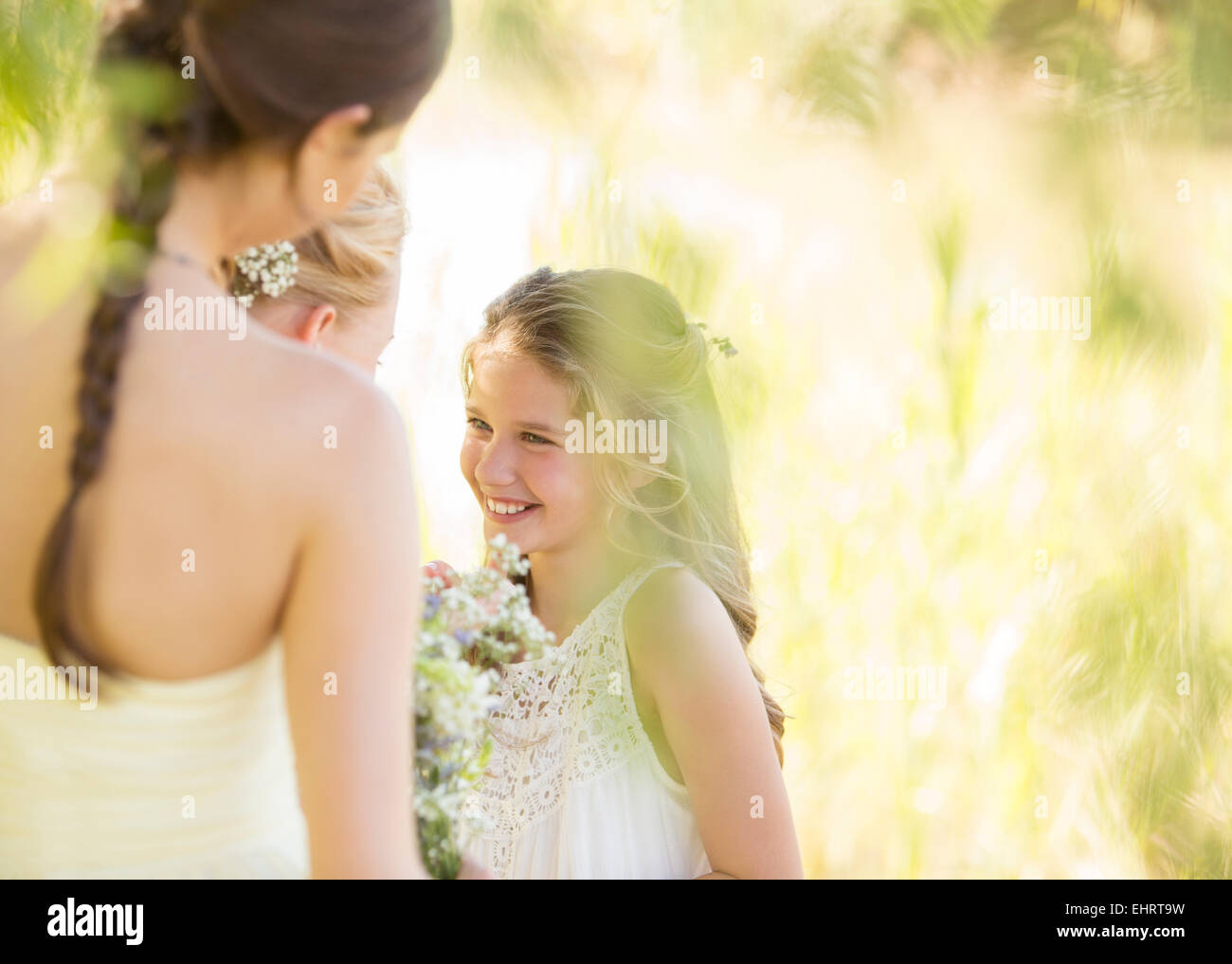 Bridesmaid With Bouquet Of Flowers During Wedding