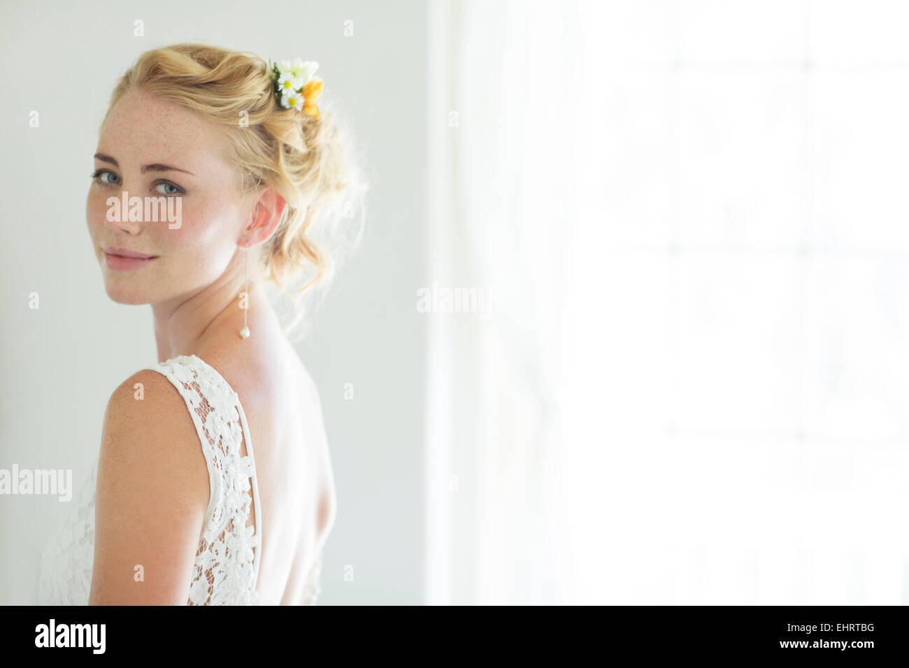 Portrait of bride in domestic room - Stock Image
