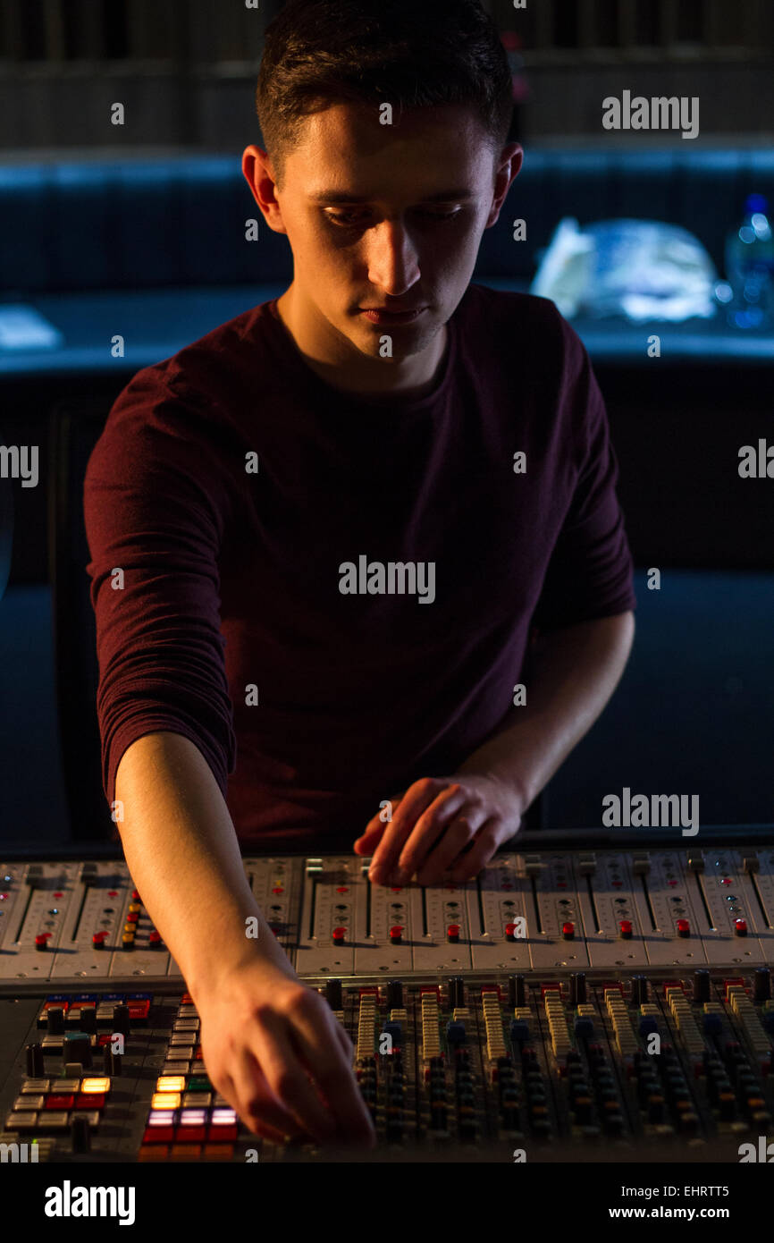 Ben working on the Never audio desk. Recording a live music session. Stock Photo