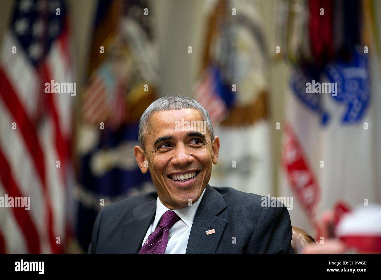 US President Barack Obama laughs during a meeting in the Roosevelt Room of the White House November 17, 2014 in - Stock Image