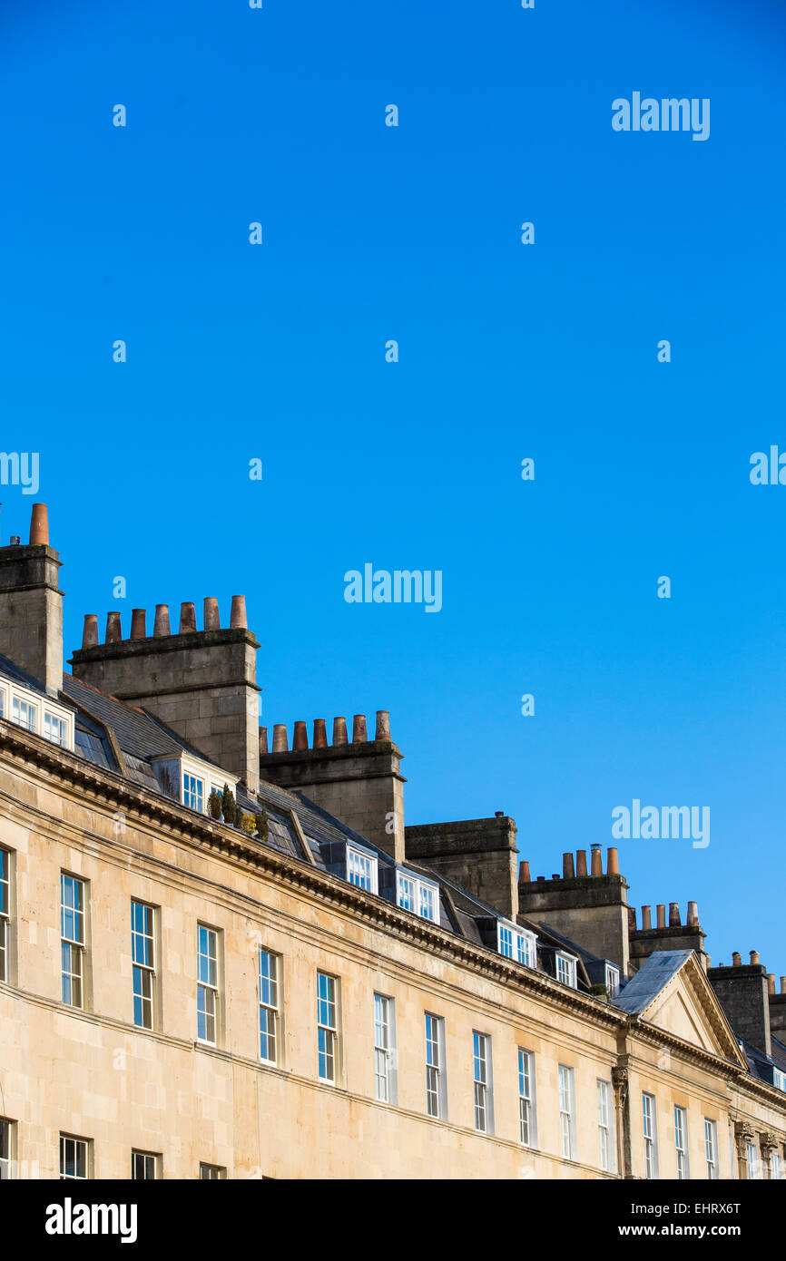 Angled view of terraced Georgian houses in Bath, Somerset, on a sunny day with clear blue sky. Stock Photo