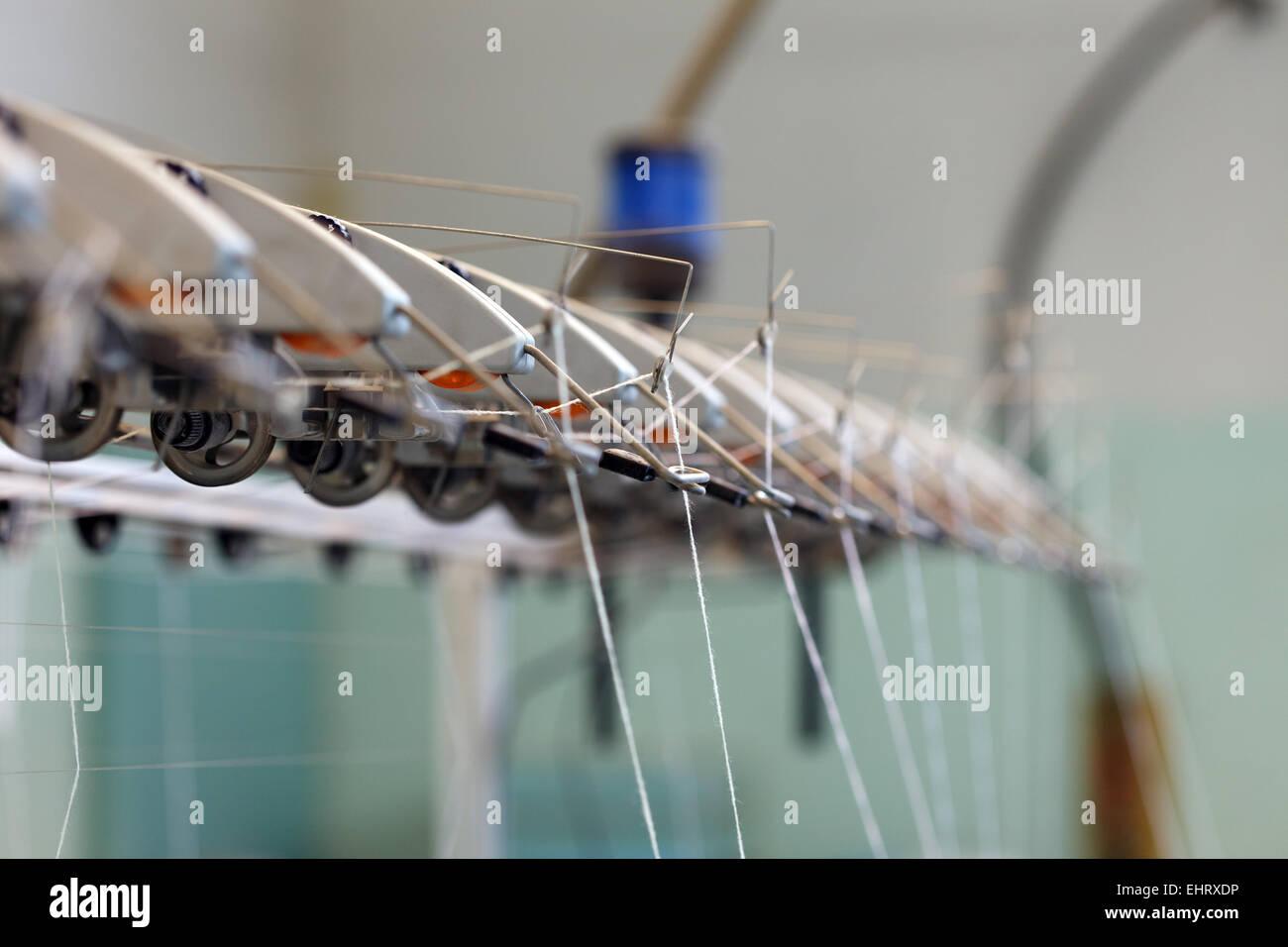 Image thread in holders on loom Stock Photo