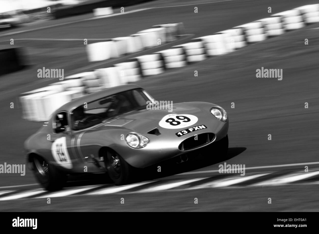 Low Drag Jaguar E-Type blasts its way out of the chicane at Goodwood Motorcircuit during Members Meeting 73 testing - Stock Image