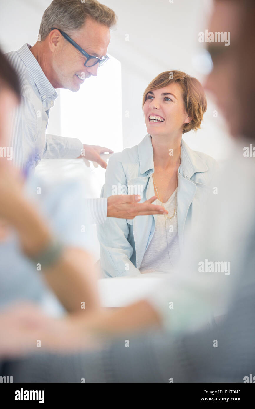 Office workers talking at meeting - Stock Image