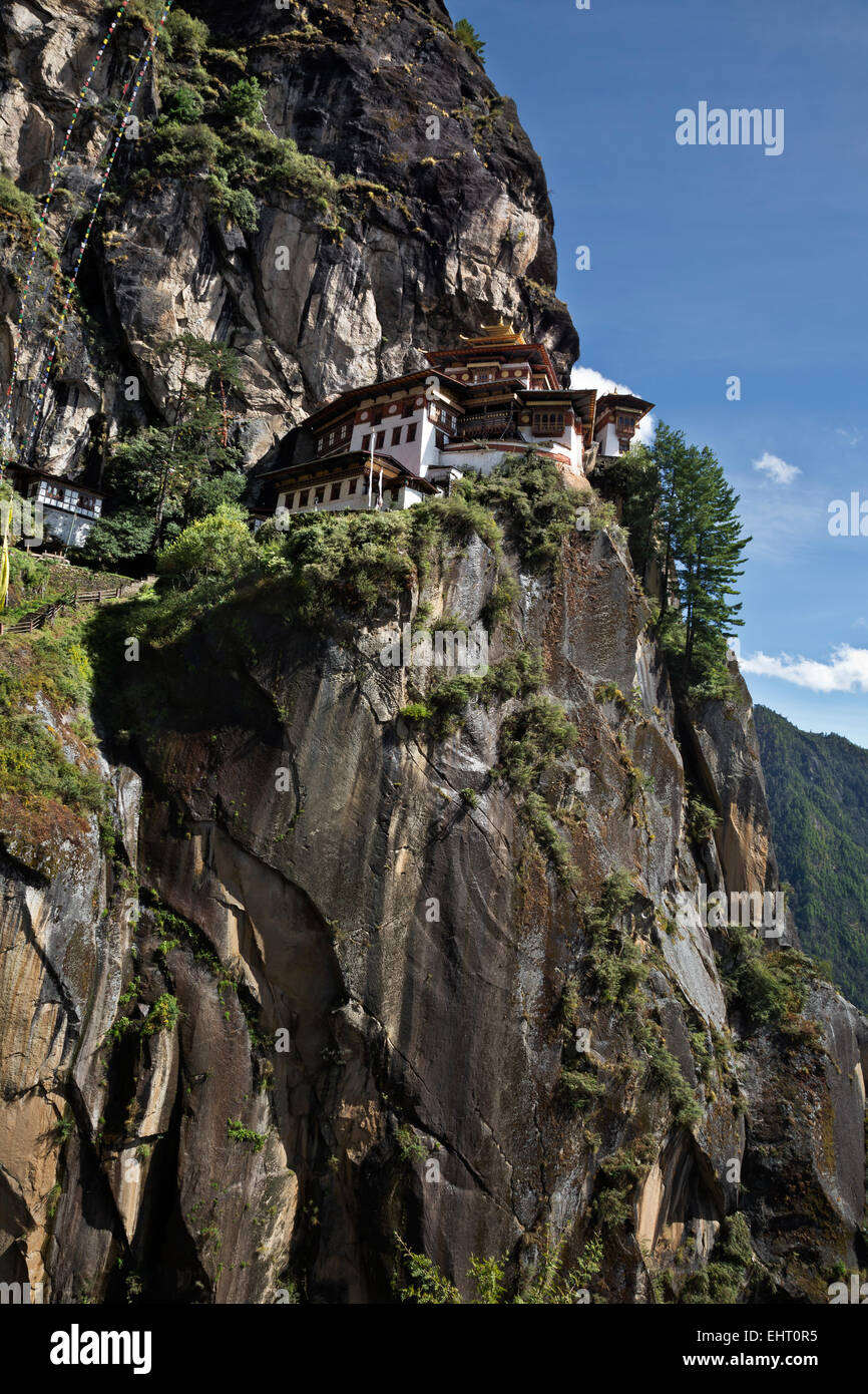 BHUTAN - Taktshang Goemba, (the Tiger's Nest Monastery), perched on the side of a cliff high above the Paro River Stock Photo