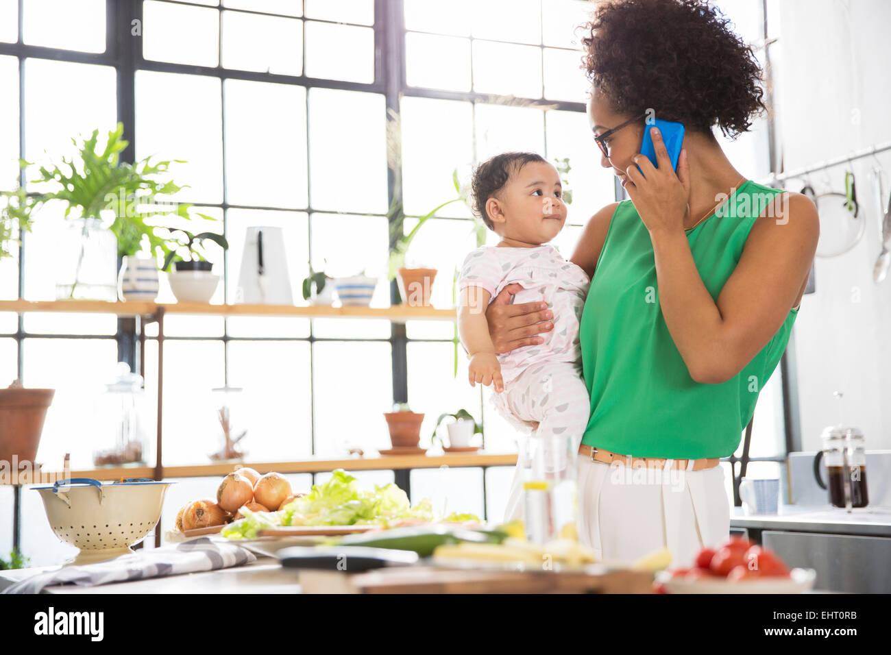 Mom Multitasking Kitchen Stock Photos & Mom Multitasking Kitchen ...