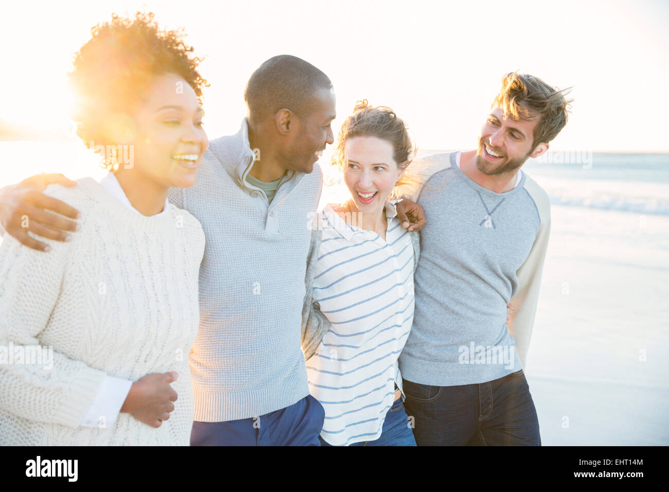Group of cheerful friends on beach - Stock Image