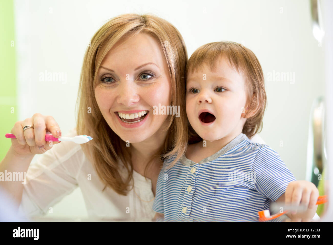 mother teaching child teeth brushing Stock Photo