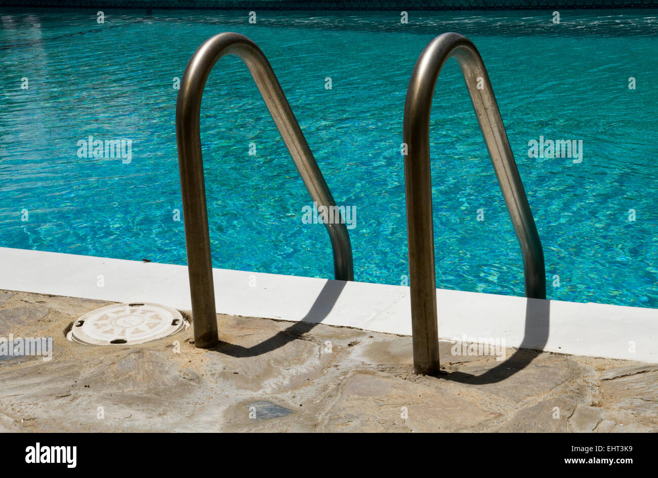 Hand rails for a swimming pool in the West Indies Stock Photo