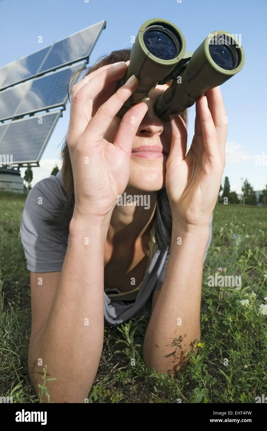 woman observe on the grass - Stock Image
