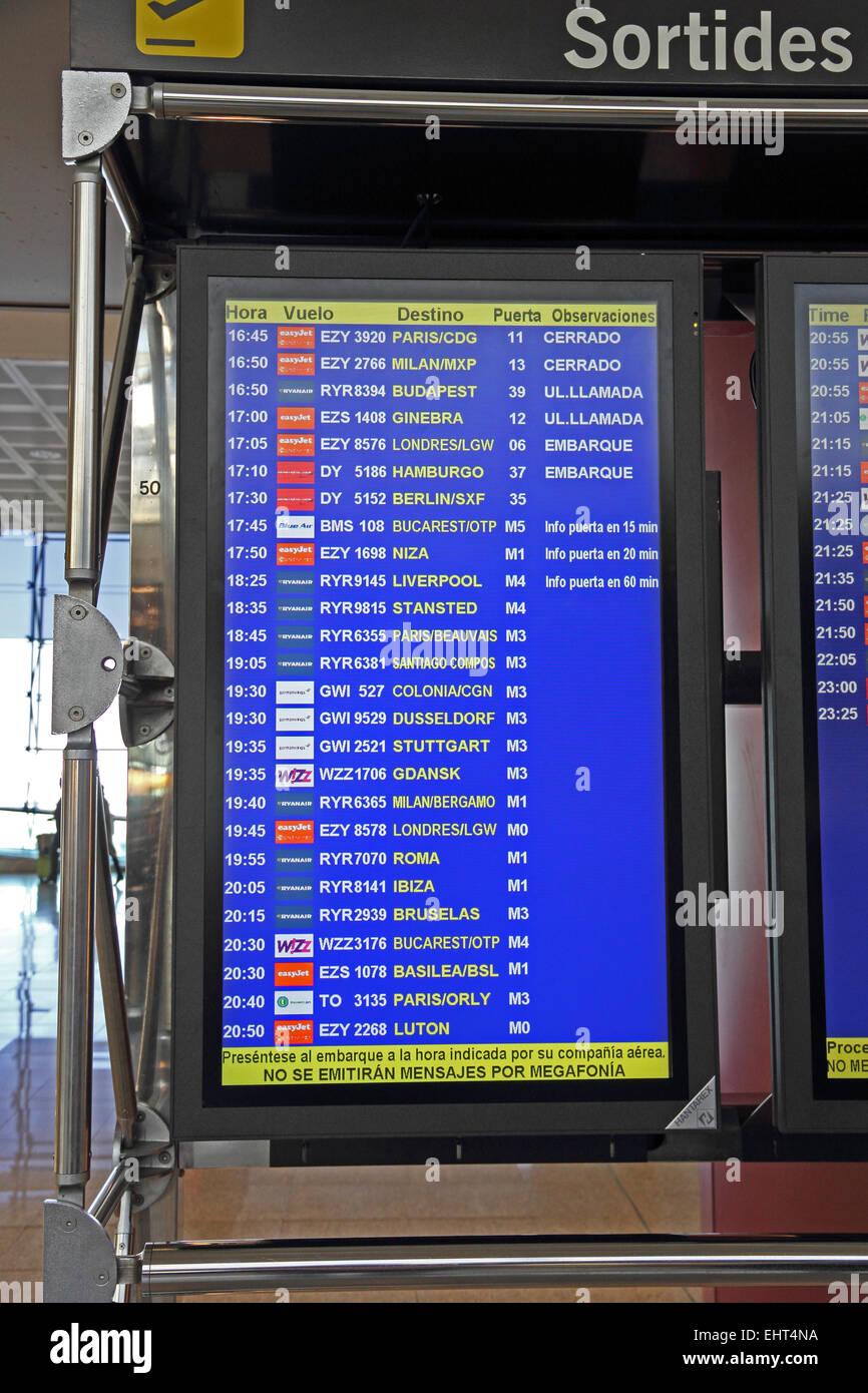 Departures board at Barcelona El Prat airport - Stock Image