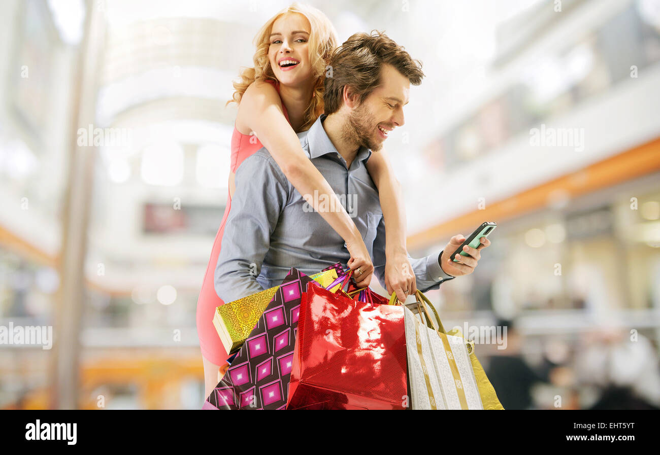 Delighted young couple on the shopping - Stock Image