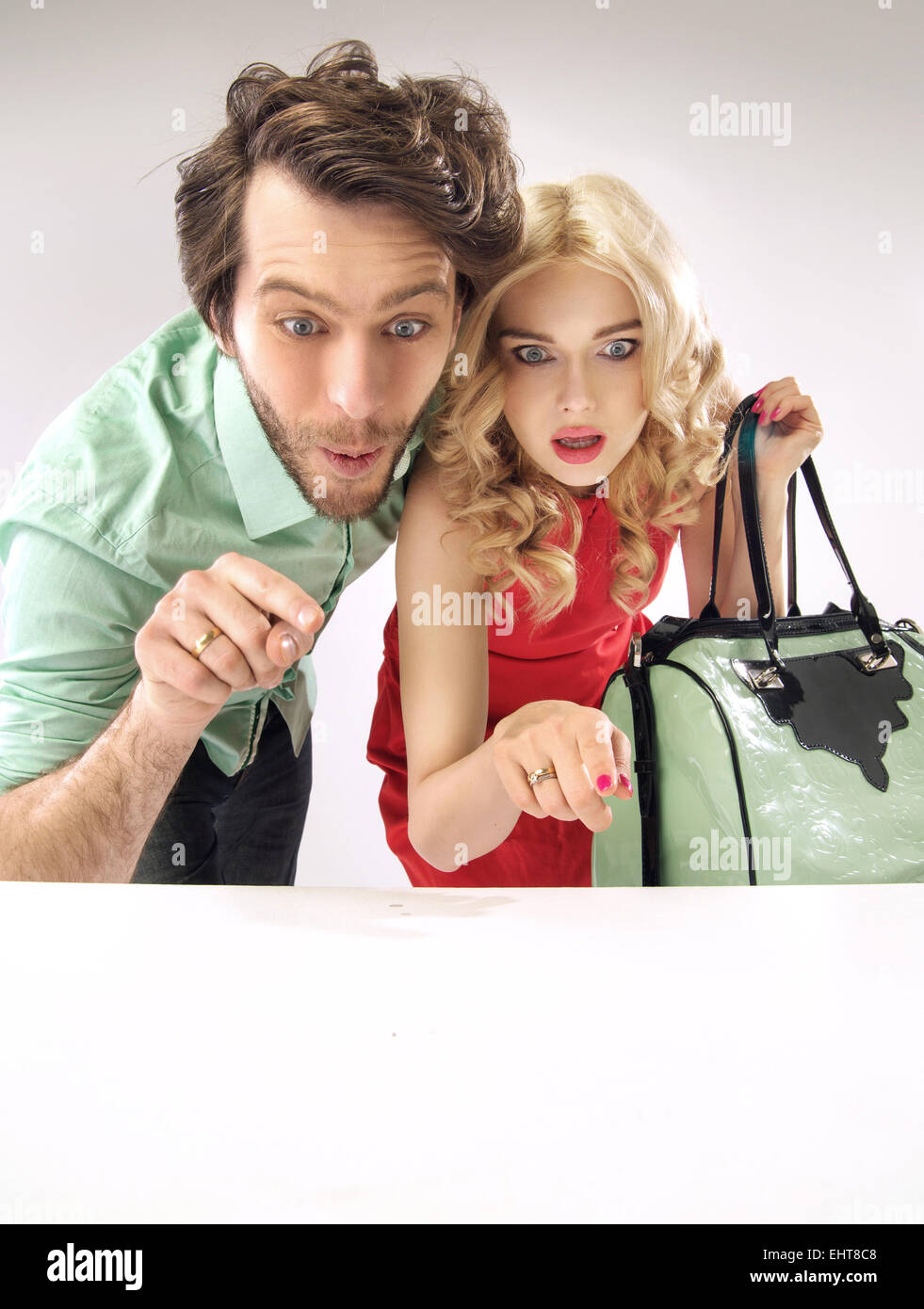 Amazed couple staring at enormous sales - Stock Image