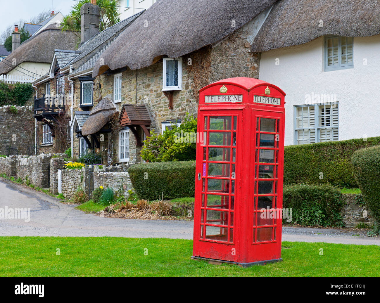 Phone box and thatched cottages at Lower Batson, near Salcombe, Devon, England UK - Stock Image