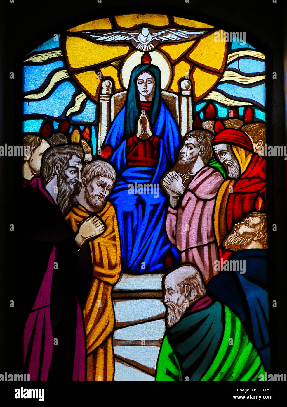 Stained glass window depicting the Descent of the Holy Spirit at Pentecost in the Church of Ostuni, Apulia, Italia - Stock Image