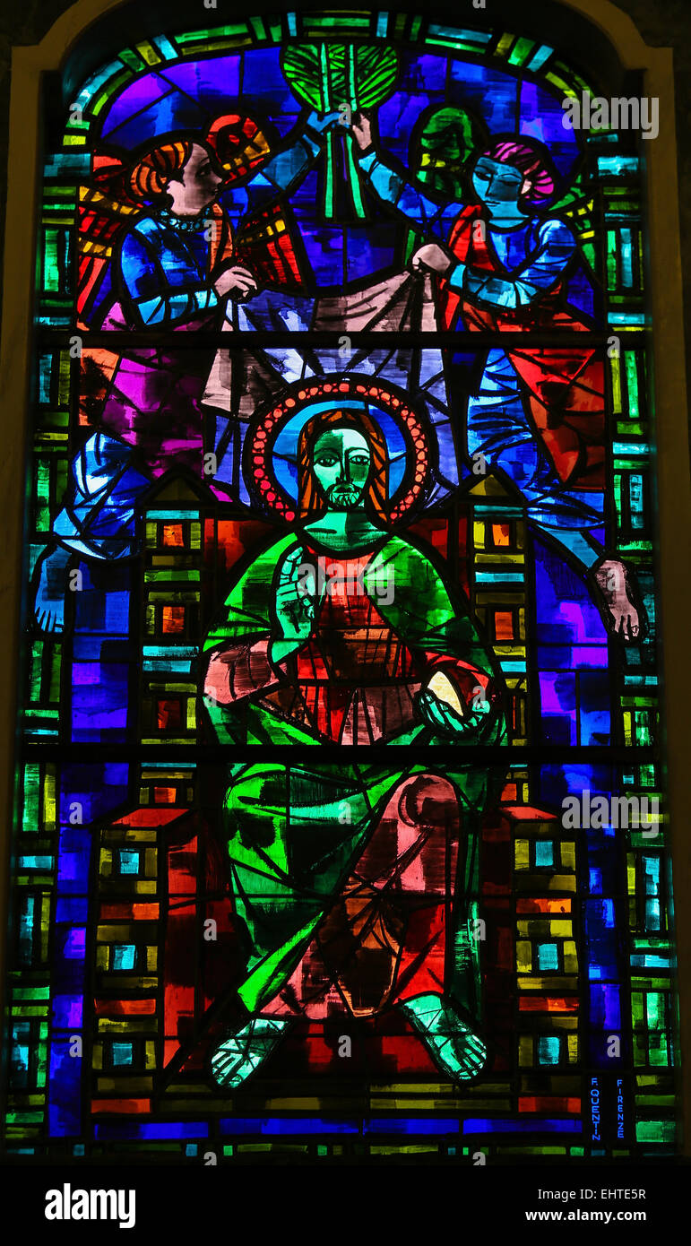 Stained glass window depicting Jesus Christ giving a blessing in the Church of Martina Franca, Apulia, Italy. - Stock Image