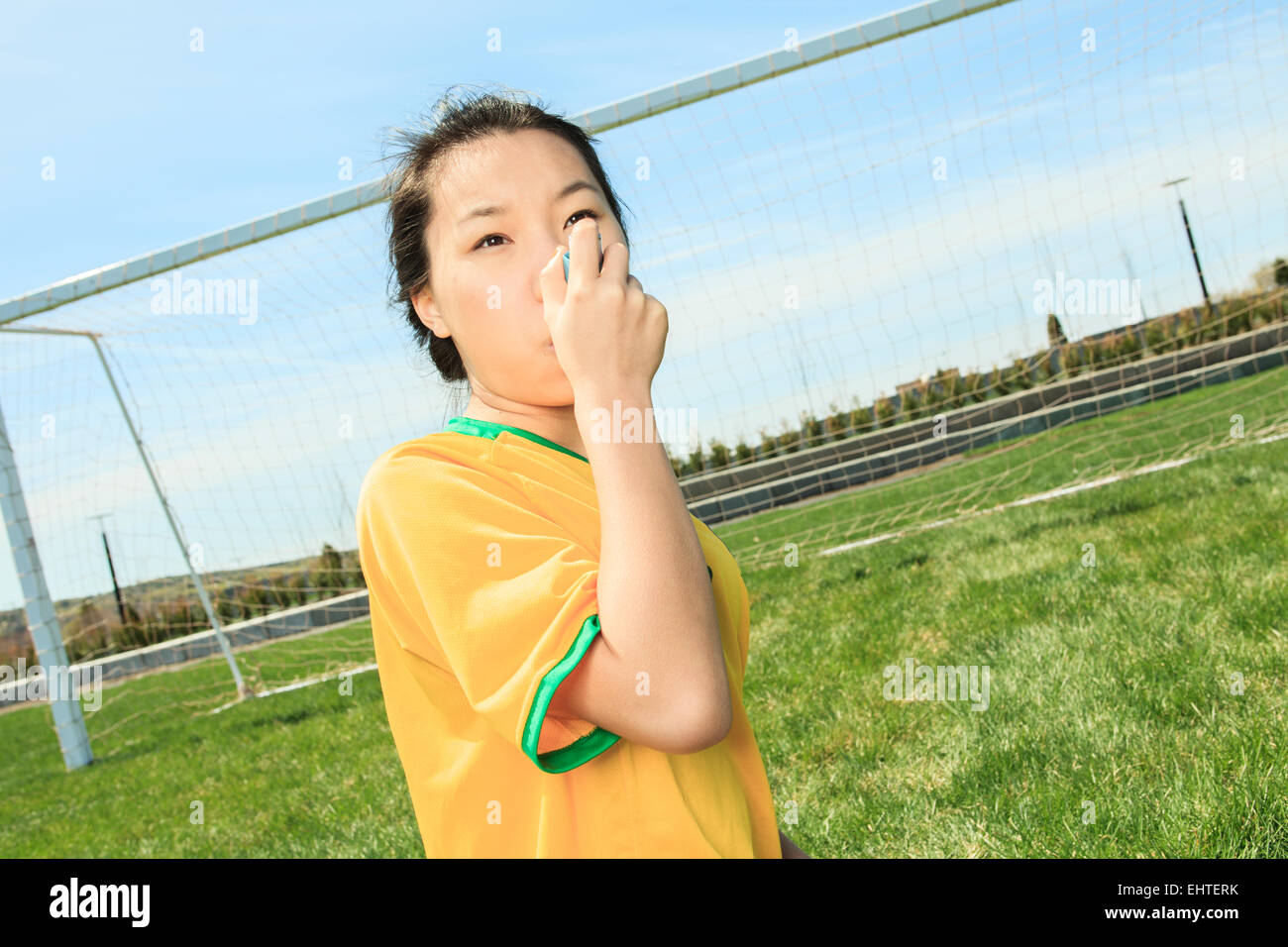 Portrait of young Asian girl inhalator - Stock Image