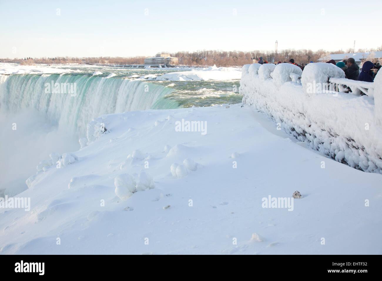 TORONTO - FEBRUARY 28,2015: Tourists flock to see Niagara Falls partially frozen on February 28, 2015. - Stock Image