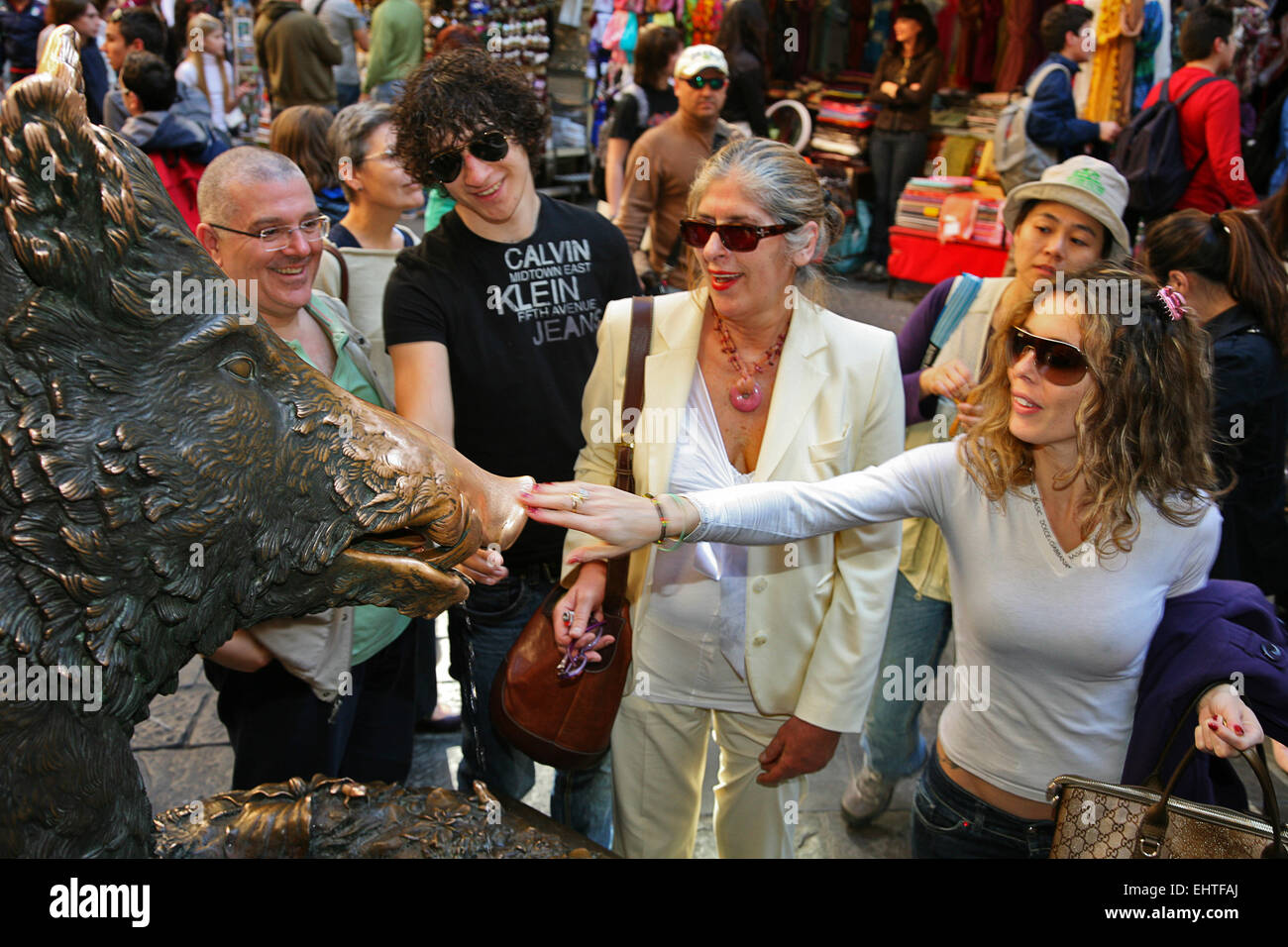 Rubbing the nose of the Little Pig at the Mercato Nuovo in Florence is said to guarantee that you will return to - Stock Image