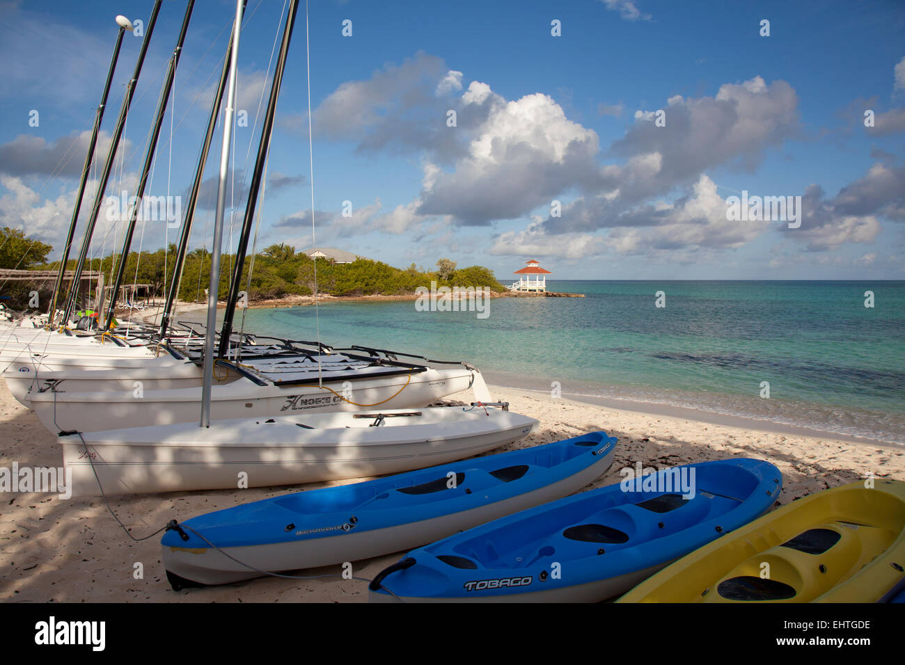 SANTA CLARA, CUBA - JANUARY 7, 2015: Kayaks and catamarans on beach in Santa Clara, Cuba, where watersport activities - Stock Image