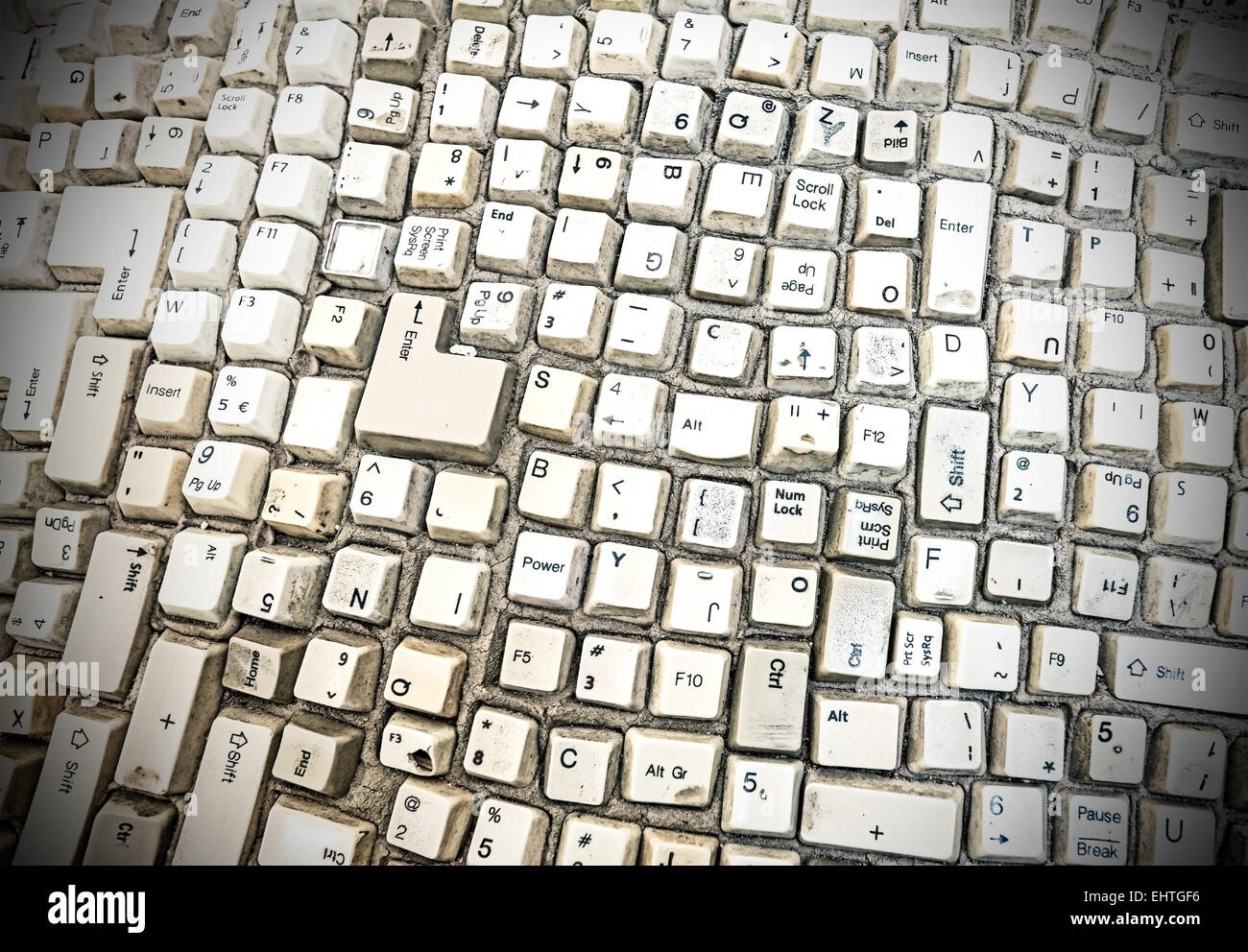 Grungy abstract background made of computer keyboard keys. - Stock Image
