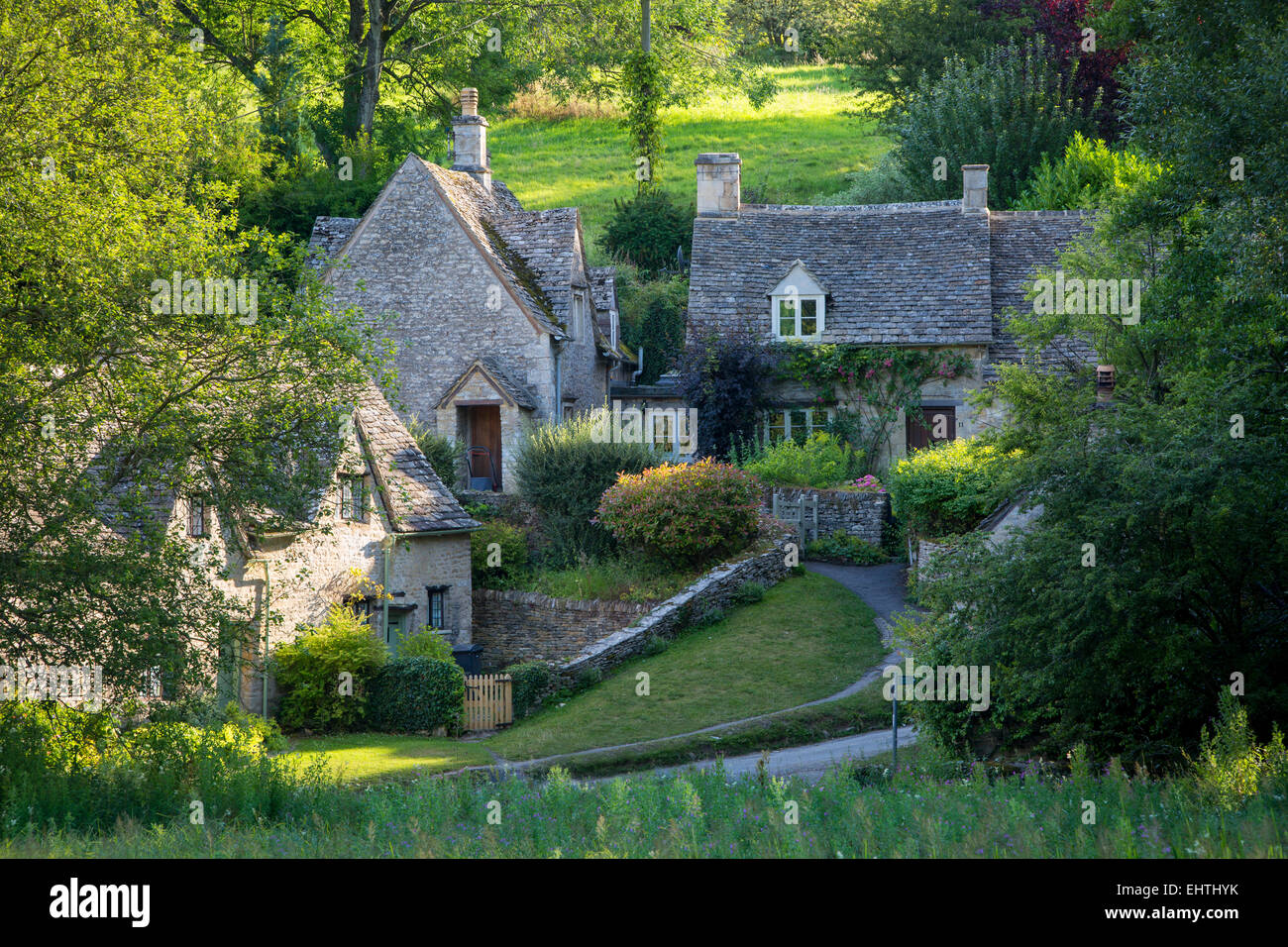 Arlington Row - cottage homes originally built for the local weavers, Bibury, Glocestershire, England Stock Photo