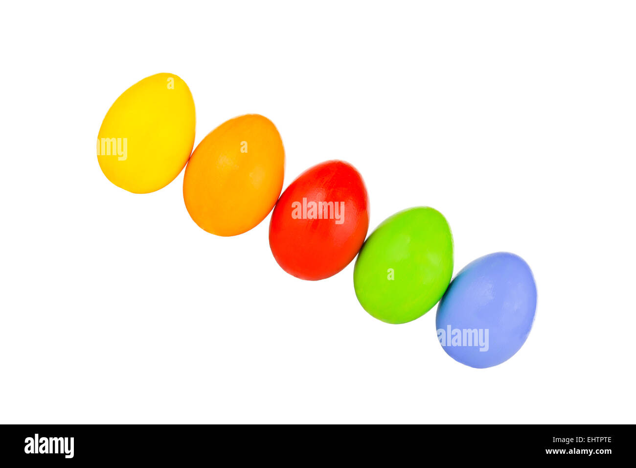 coloured easter eggs in a row 6 - Stock Image