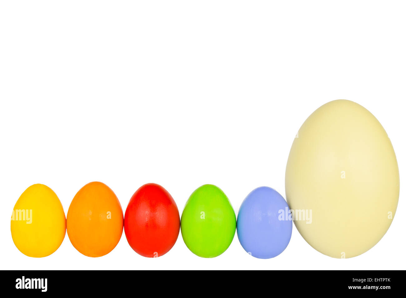 coloured easter eggs in a row 5 - Stock Image