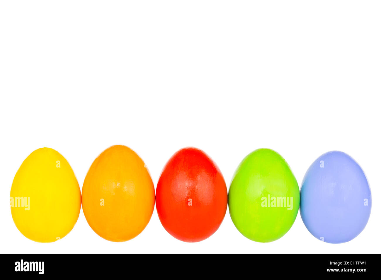 coloured easter eggs in a row 2 - Stock Image