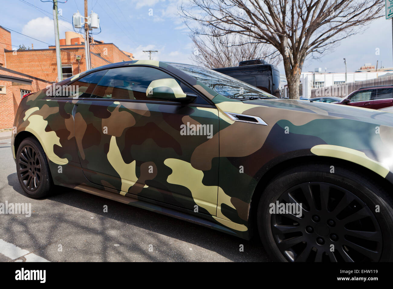 2143e9e018 Car with military camouflage pattern wrap - USA - Stock Image