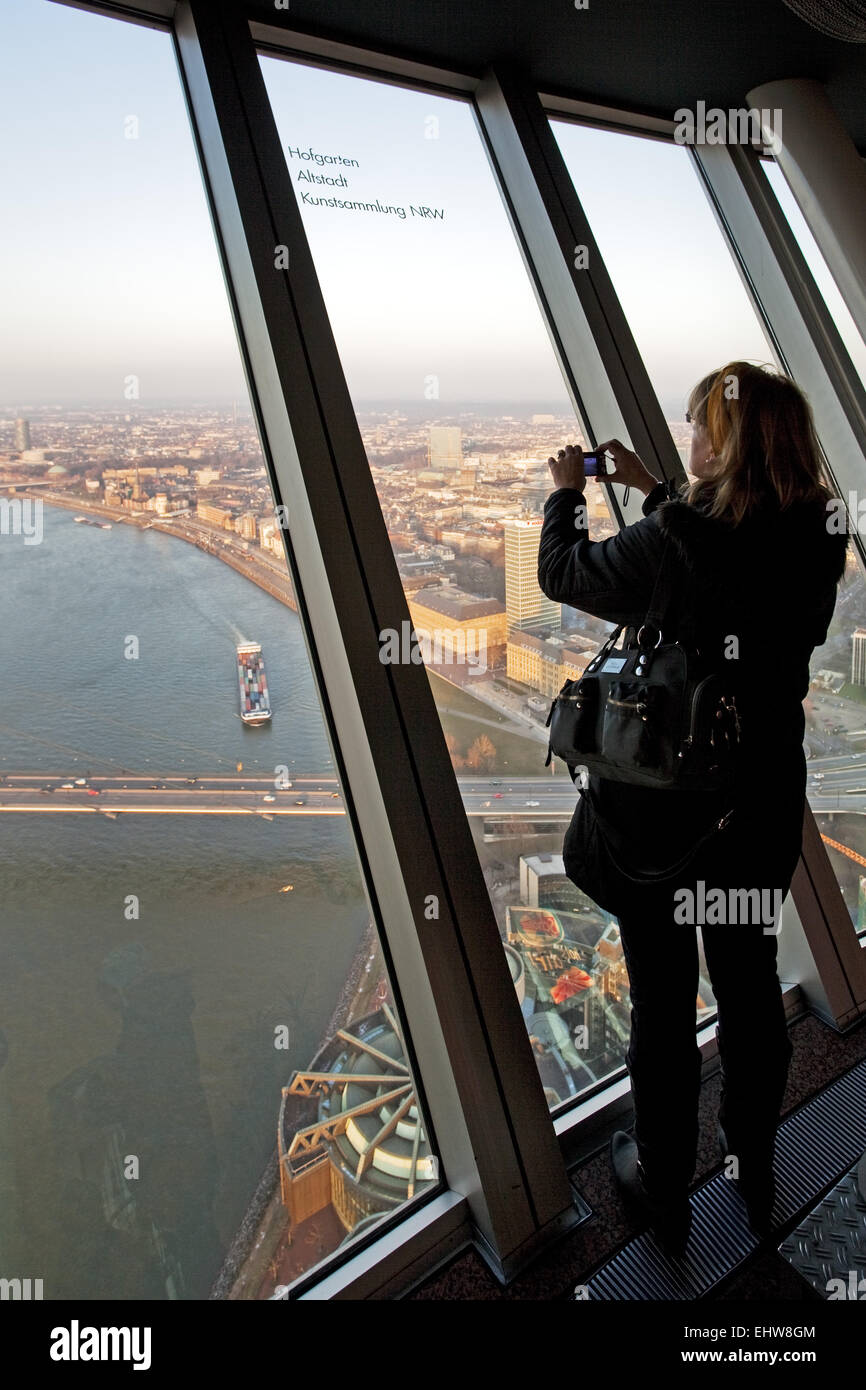 A woman photographed from the Rhine Tower. - Stock Image